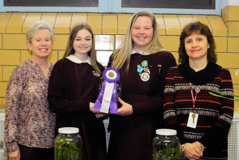 Little Flower High School students proudly display their winning ribbon at the Flower Show.