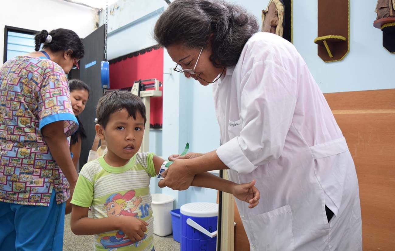 A doctor measures the arms of a child attending the local SAMAN nutrition clinic, a partnership between sisters of Our Lady of the Immaculate Conception of Castres and Caritas Internationalis. (CNS photo/Cody Weddle, GSR)