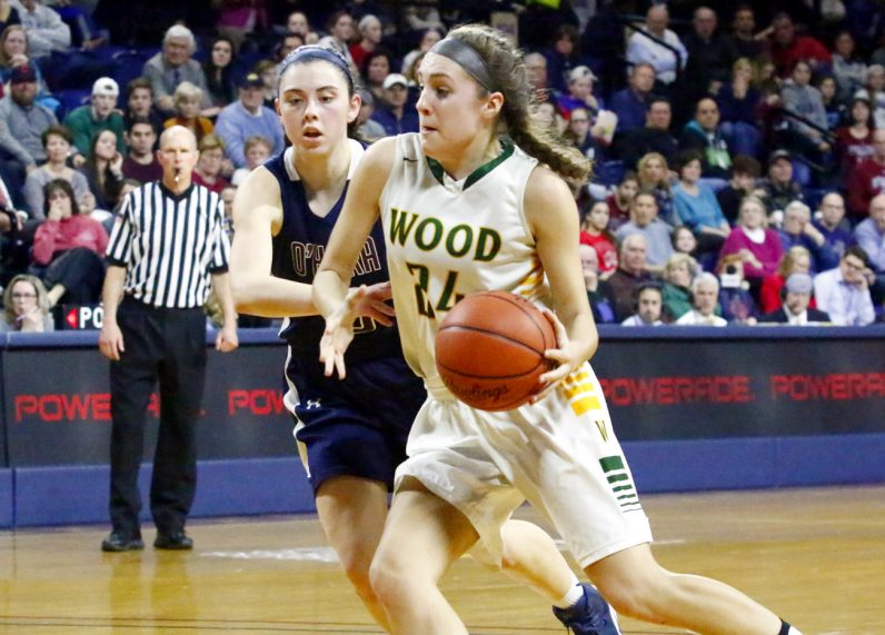 Wood's Katie May drives to the basket with O'Hara's Mary Sheehan on her heels.