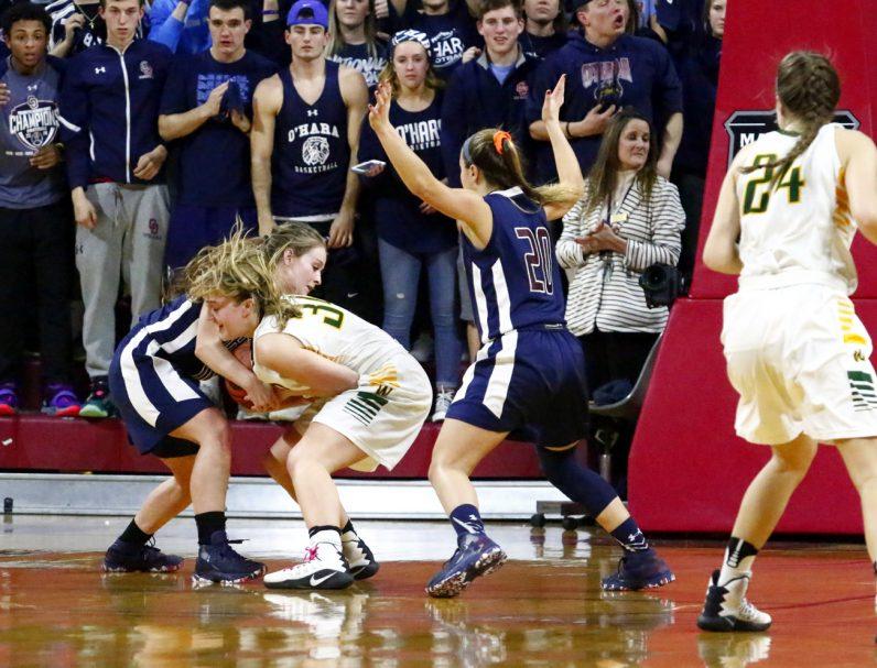 O'Hara's Lauren Leicht battles Wood's Meg Neher for the ball.
