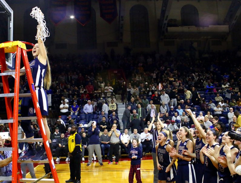 O'Hara senior Hannah Nihill cheers after the celebratory cutting of the net after the championship victory.