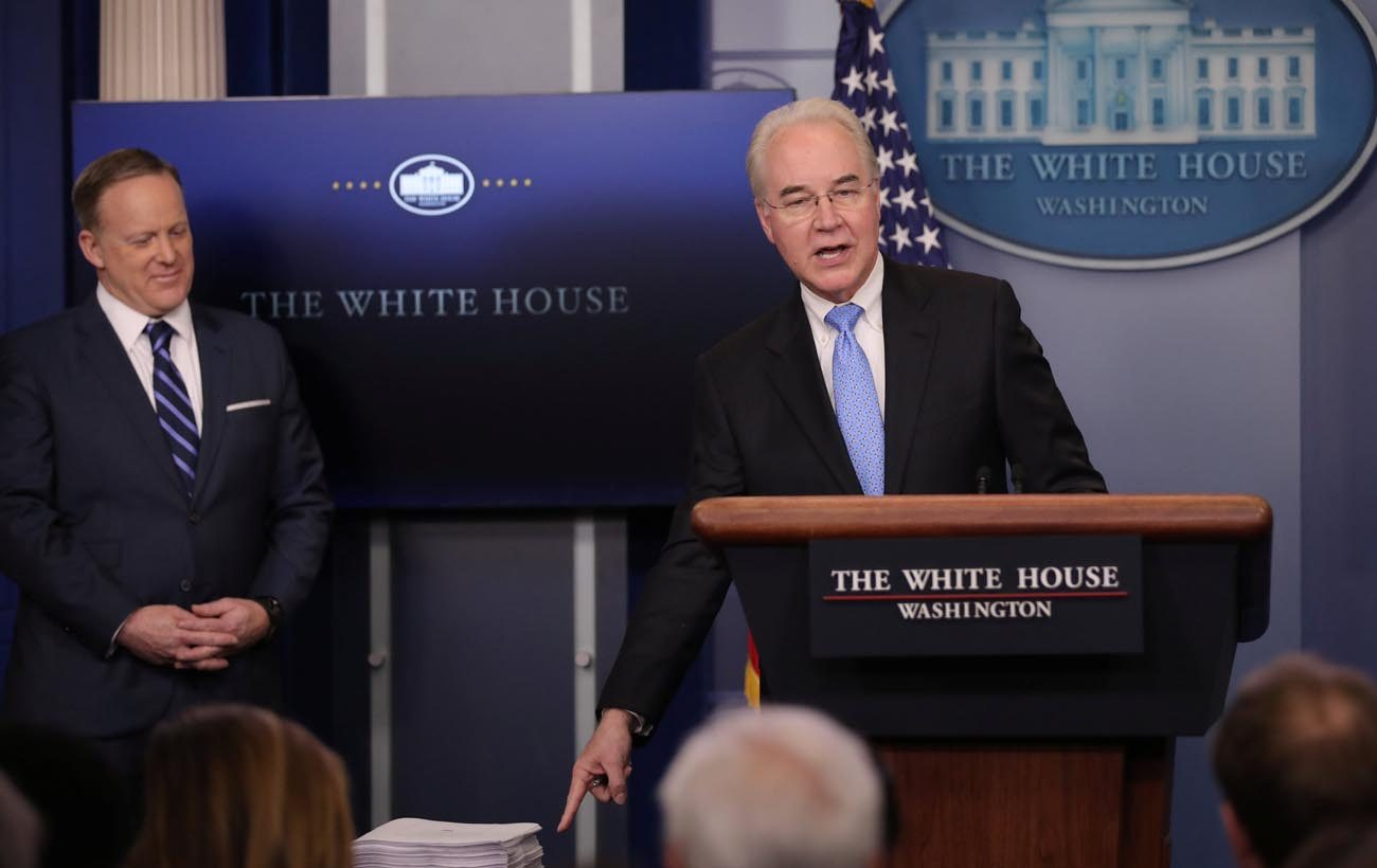 U.S. Health and Human Services Secretary Tom Price gestures at a stack of papers that he said was the Affordable Care Act during a March 7 press briefing as White House Press Secretary Sean Spicer looks on at the White House in Washington. The law, as passed in 2010, was 906 pages long. Republicans in the U.S. House have introduced a measure to repeal and replace the federal health care law.  (CNS photo/Carlos Barria, Reuters)