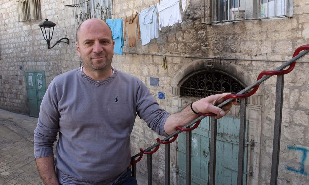 Palestinian Christian Sami Awad, founder and executive director of the Holy Land Trust, poses outside his office Feb. 27 in Bethlehem. (CNS photo/Debbie Hill)