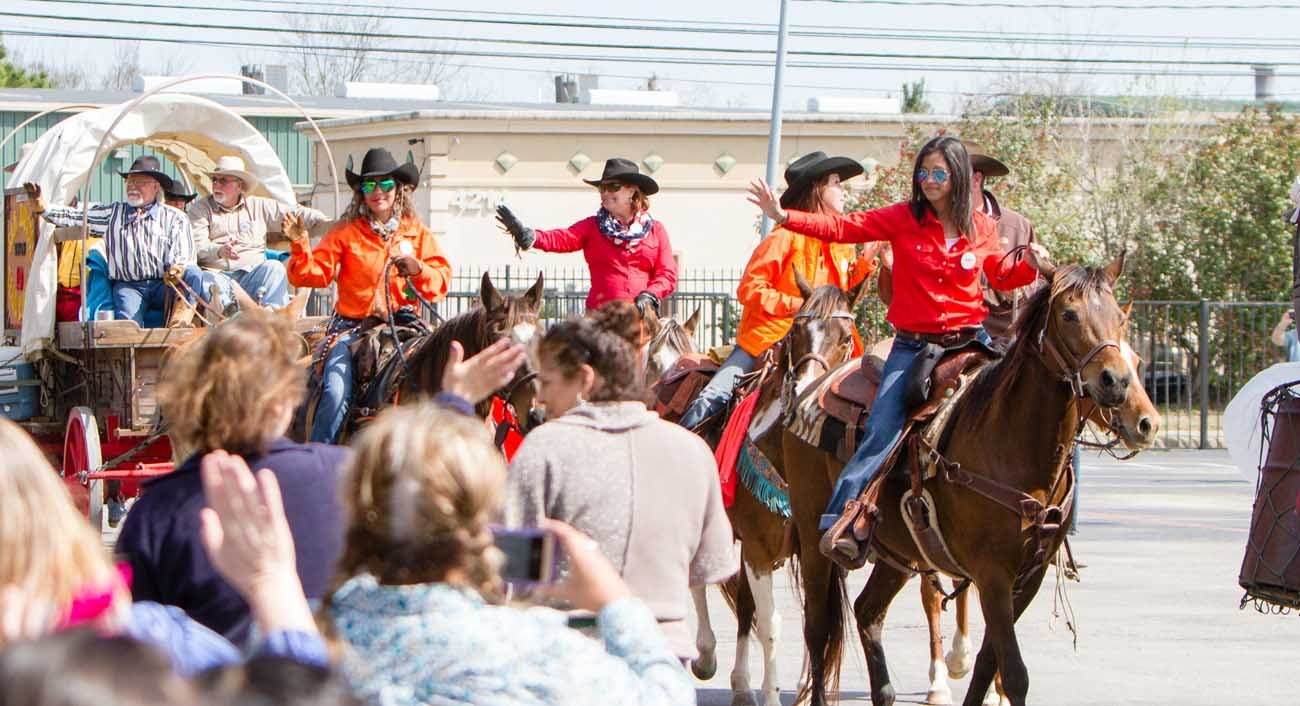 Members of the Sam Houston Trail Riders wave to students at St. Ambrose Catholic School in Houston March 3. (CNS photo/James Ramos, Texas Catholic Herald)