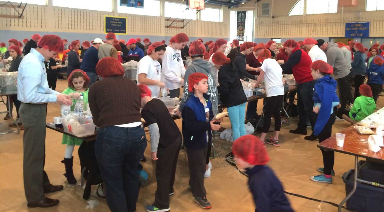 Some 280 volunteers led by the Catholic Young Adults of Chester County came together March 12  at St. Monica Parish, Berwyn, to package 50,000 dry-goods meals for needy residents of Burkina Faso, West Africa, in a Catholic Relief Services-sponsored event.