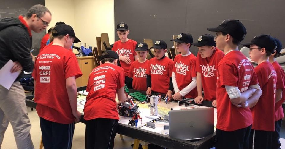 The TOBOR Red robotics team of Holy Cross Regional Catholic School in Collegeville works together on their project in the robotics competition early in March at the University of Pennsylvania.