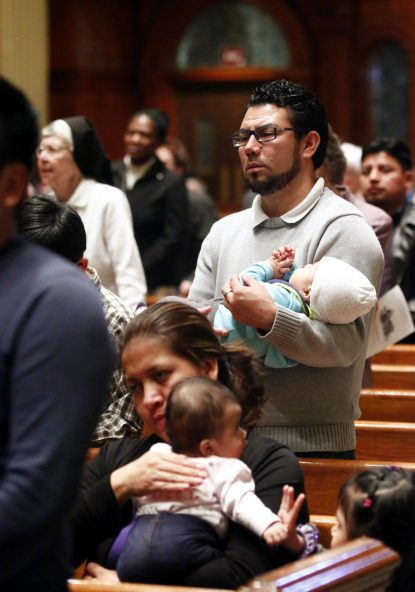 Jose Marroquin and his son Jose Jr. traveled to the cathedral from St. Rocco Parish in rural Avondale, Chester County, to attend the March 19 prayer service. (Sarah Webb)