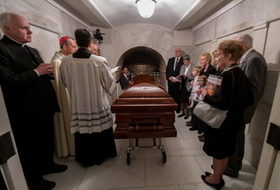 Baltimore Archbishop William E. Lori gives the final blessing over the casket of Cardinal William H. Keeler, retired archbishop of Baltimore, March 28 in the crypt of the Basilica of the Shrine of the Assumption of the Blessed Virgin Mary in Baltimore. (CNS photo/Kevin J. Parks, Catholic Review)