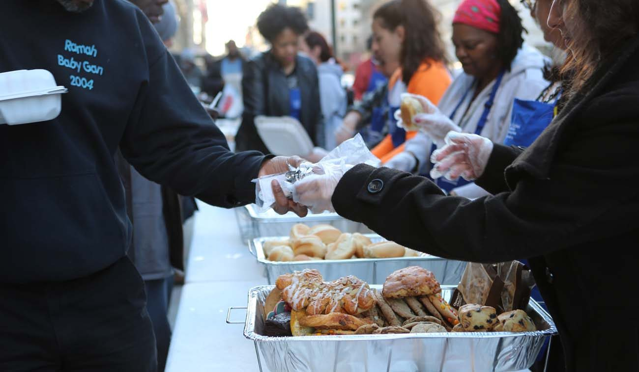 Volunteers with Catholic Charities' St. Maria's meals program in Washington serve dinner March 8 to the homeless. (CNS photo/Chaz Muth)