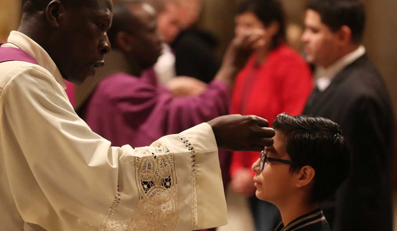 A child receives ashes during Ash Wednesday Mass March 1 in the Crypt Church at the Basilica of the National Shrine of the Immaculate Conception in Washington. (CNS photo/Bob Roller)