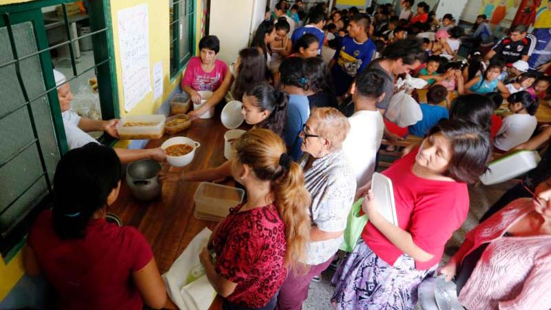 """People receive food rations at a community soup kitchen in Buenos Aires, Argentina, Feb. 13, 2014. Pope Francis views Lent as a time to """"open our doors to the weak and poor."""" (CNS photo/Enrique Marcarian, Reuters)"""