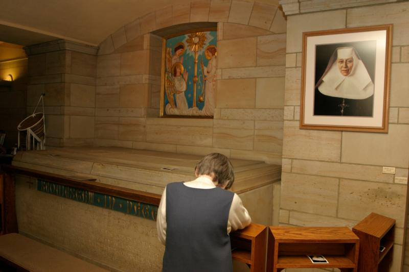 A Sister of the Blessed Sacrament prays before the tomb of the congregation's foundress, St. Katharine Drexel, in May 2016 at the motherhouse in Bensalem, Pa. Her feast day of March 3 stands like a beacon at the beginning of Lent. (CNS photo/Sarah Webb, CatholicPhilly.com)