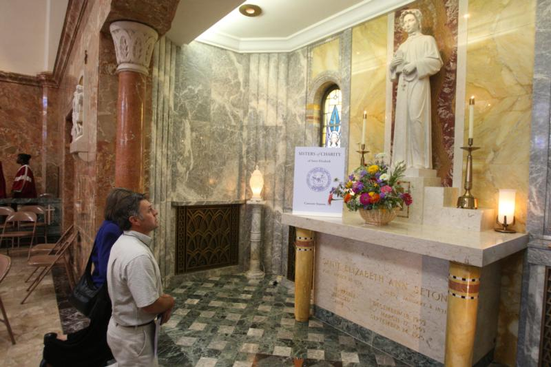 Ivan Pare prays before a statue of St. Elizabeth Ann Seton at the Basilica of the National Shrine of St. Elizabeth Ann Seton in Emmitsburg, Md., after a Mass celebrated Aug. 2, 2009, to mark the 200th anniversary of the foundation of the Sisters of Charity. (CNS photo/Owen Sweeney III, Catholic Review)