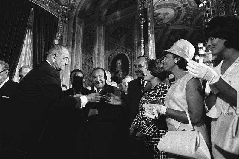 "U.S. President Lyndon B. Johnson is pictured in this 1964 photo with a group of civil rights leaders who include the Rev. Martin Luther King Jr., Clarence Mitchell and Patricia Roberts Harris. As our nation saw the passage of the Civil Rights Act in 1964 and the emergence of the War on Poverty, the Catholic Church saw the advent of a landmark expression of its own social doctrine when Blessed Paul VI promulgated ""Populorum Progressio,"" ""The Progress of Peoples,"" in 1967. (CNS photo/Yoichi Okamoto, courtesy LBJ Library)"
