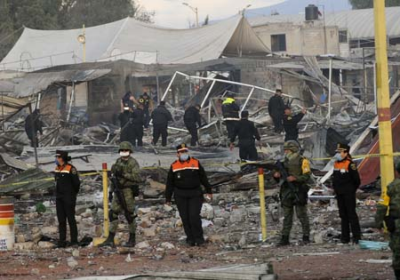 Members of the Mexican Civil Protection and the army work at the site of a deadly explosion in 2016 at a fireworks market in Tultepec, Mexico. The explosion claimed the lives of 42 people. (CNS photo/EPA)