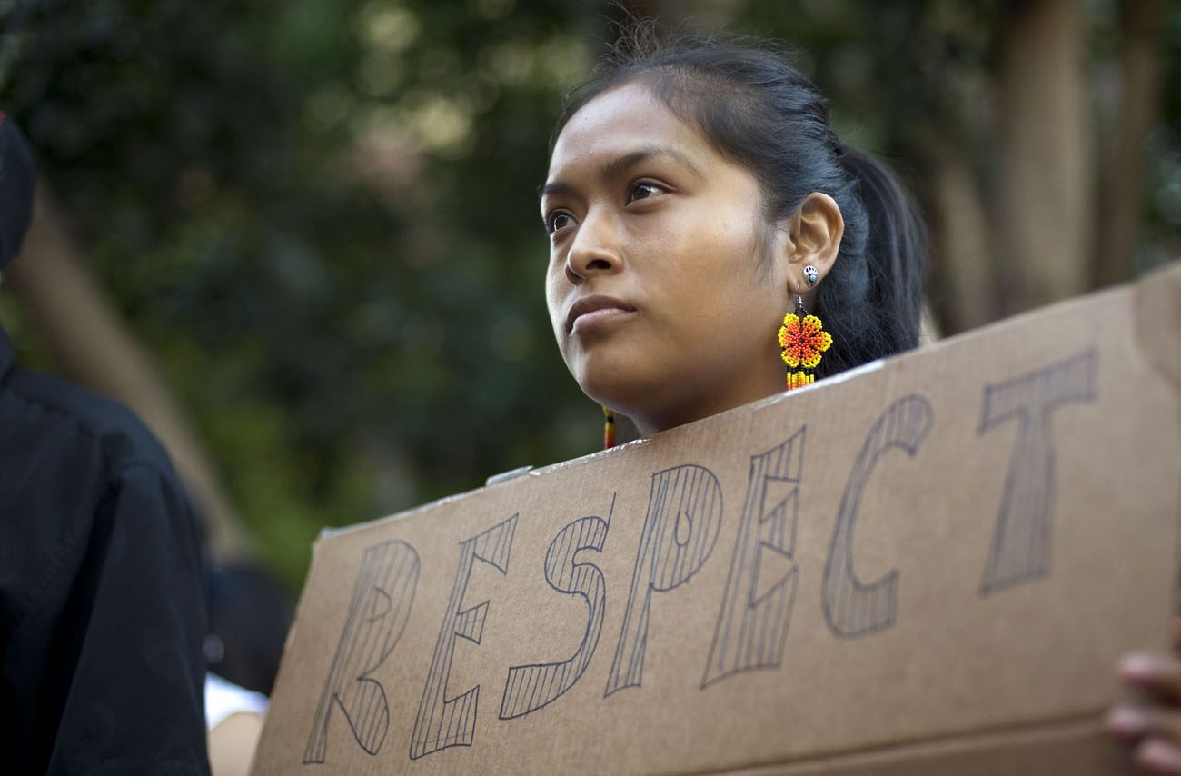 Woman in San Diego attends a vigil and rally July 9, 2014, to show support for undocumented Central American minors flooding across the U.S.-Mexico border and protest them being apprehended by authorities. (CNS photo/David Maung, EPA)