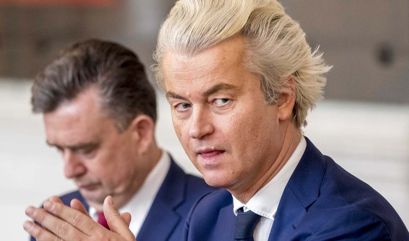Geert Wilders, head of the nationalist Party for Freedom, attends a March 16 meeting in The Hague, Netherlands. Prime Minister Mark Rutte's center-right People's Party claimed victory with 21 percent of votes, over 13 percent gained by the nationalist Party for Freedom in voting March 15. The Party for Freedom campaigned for banning the Quran and closing mosques and Islamic schools. (CNS photo/Jerry Lapen, EPA)