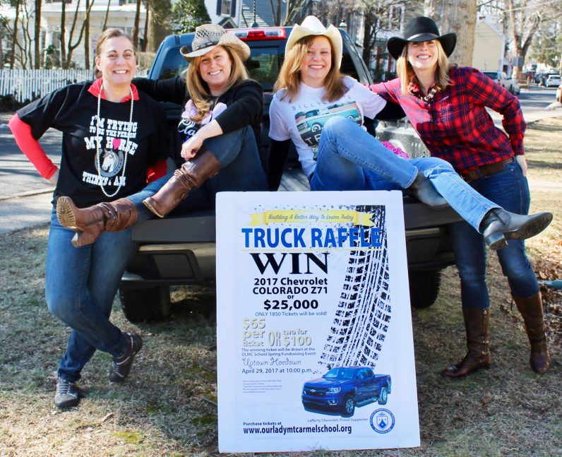 Pictured with the 2017 Chevrolet Colorado Z71, which will be raffled off at the Uptown Hoedown fundraiser for Our Lady of Mount Carmel School in Doylestown, are committee chairwomen (from left) Bea Allen, Deann Janczak, Susan Kerrigan and Karen McAndrews.
