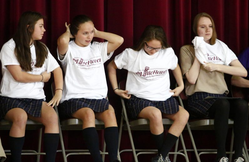 From left, Abigail Galazka, Alayna DeNight, Emily Dillon and Olga Szczesny don T-shirts showing they'll be attending Little Flower High School next year.