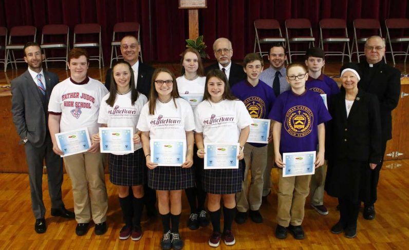 Students of Our Lady of Port Richmond School, Philadelphia, show their $2,000 Matching Starter Scholarships along with representatives from the partnering high schools and OLPR officials. (Photo by Sarah Webb)