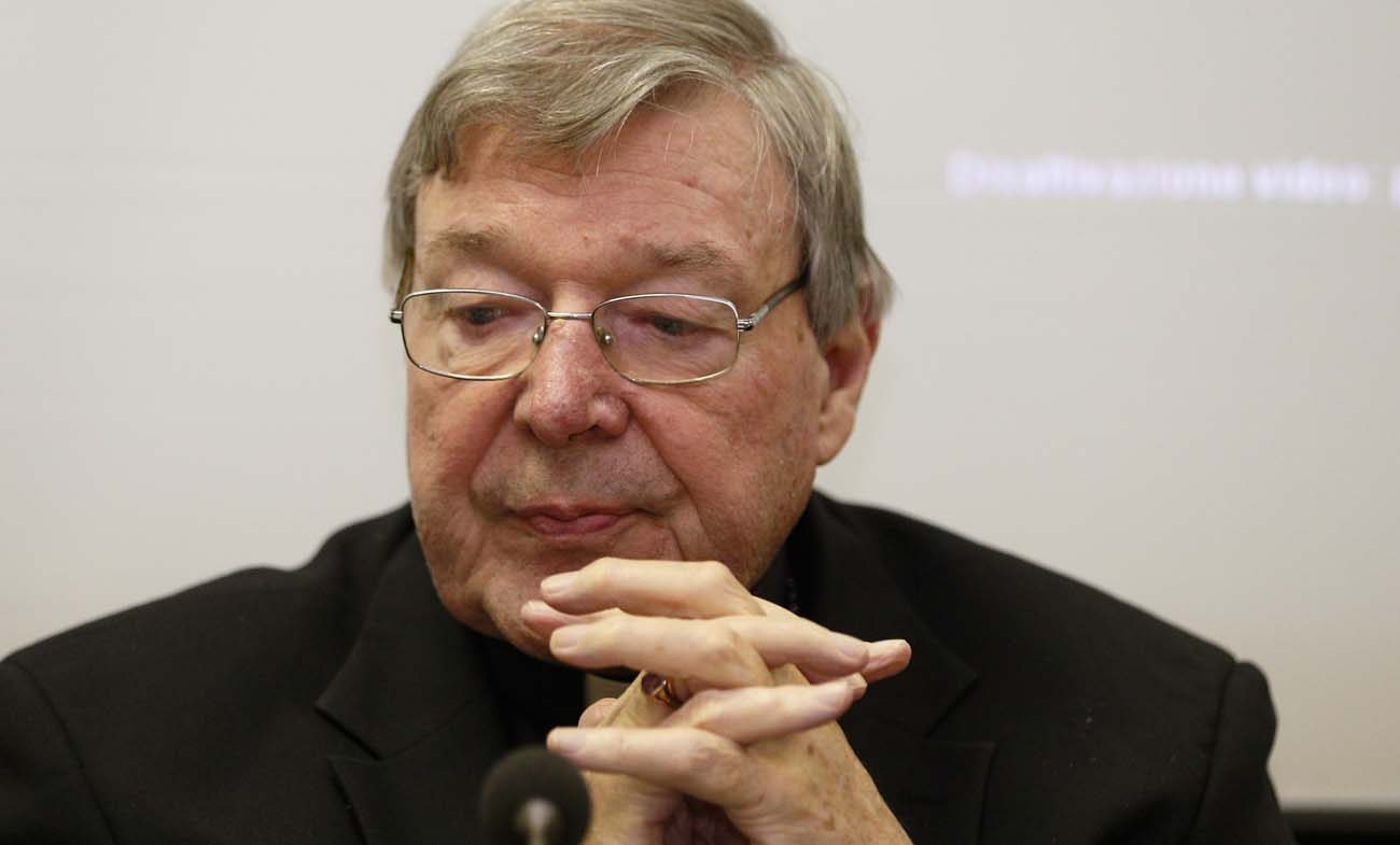 """Australian Cardinal George Pell, prefect of the Vatican's Secretariat for the Economy, attends the presentation of the book, """"Connected World,"""" at the Vatican March 28. The book by Father Philip Larrey addresses advanced technology and the rise of artificial intelligence on society. (CNS photo/Paul Haring)"""