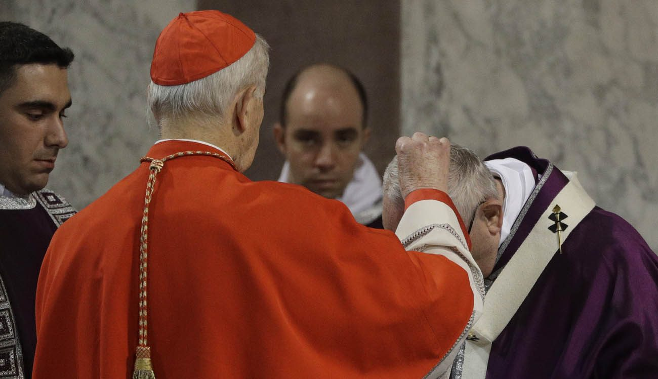 Cardinal Jozef Tomko places ashes on the head of Pope Francis during Ash Wednesday Mass at the Basilica of Santa Sabina in Rome March 1. (CNS photo)