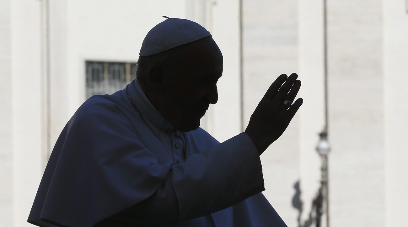 Pope Francis is silhouetted as he blesses the crowd during his general audience in St. Peter's Square at the Vatican March 1. (CNS photo/Paul Haring)