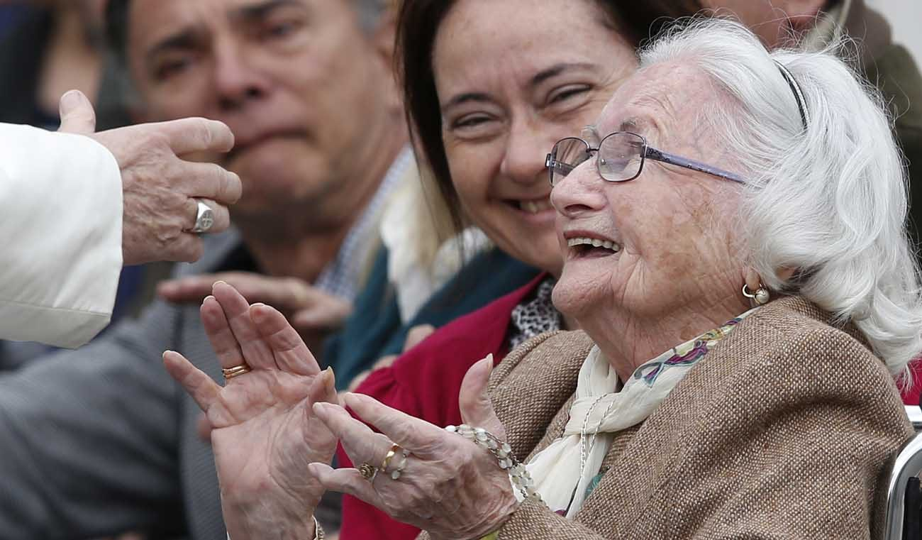 An elderly woman reacts as she meets Pope Francis during his general audience in St. Peter's Square at the Vatican March 22. (CNS photo/Paul Haring)