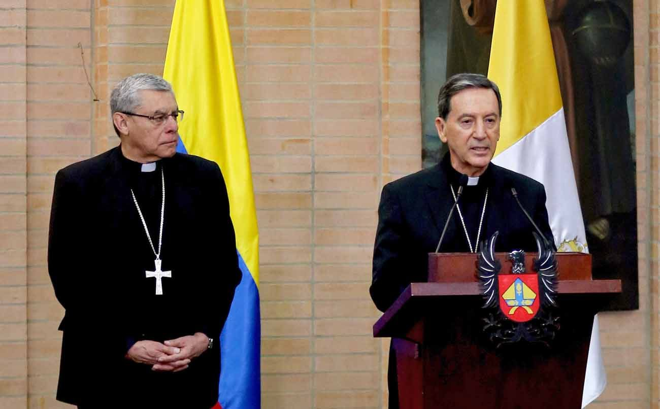 Archbishop Ettore Balestrero, apostolic nuncio to Colombia, speaks next to Cardinal Ruben Salazar Gomez of Bogota during a news conference to announce Pope Francis' upcoming trip to Colombia in September. (CNS photo/Leonardo Munoz, Reuters)