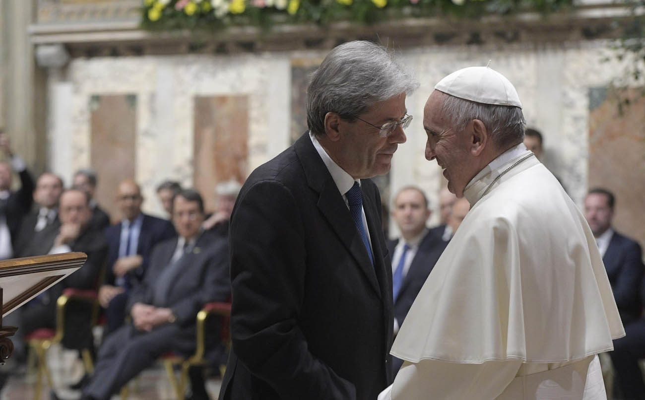 Pope Francis greets Italian Prime Minister Paolo Gentiloni during the European Union summit at the Vatican March 24. (CNS photo/L'Osservatore Romano via EPA)