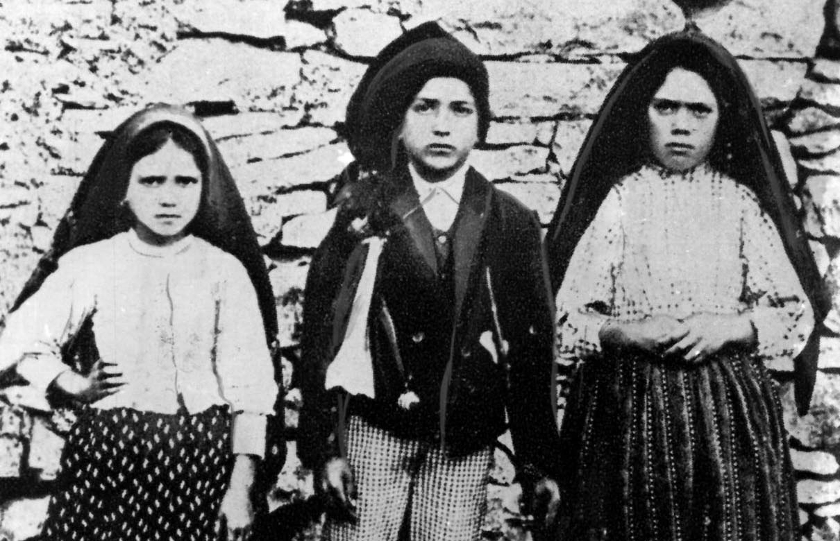 Jacinta and Francisco Marto are pictured with their cousin Lucia dos Santos (right) in a file photo taken around the time of the 1917 apparitions of Mary at Fatima, Portugal. Pope Francis has approved the recognition of a miracle attributed to the intercession of two of the shepherd children, thus paving the way for their canonization. (CNS file photo)