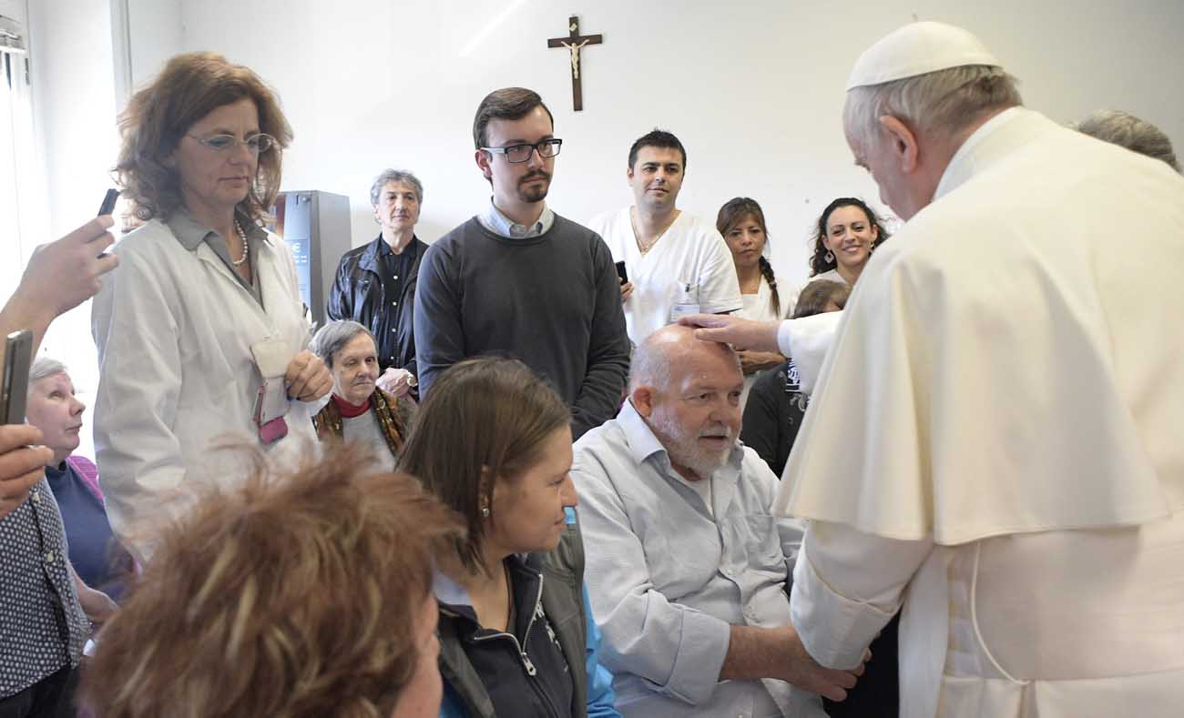 Pope Francis blesses a man during a visit to the Sant' Alessio-Margherita di Savoia Regional Center for the Blind March 31 in Rome. (CNS photo/L'Osservatore Romano)