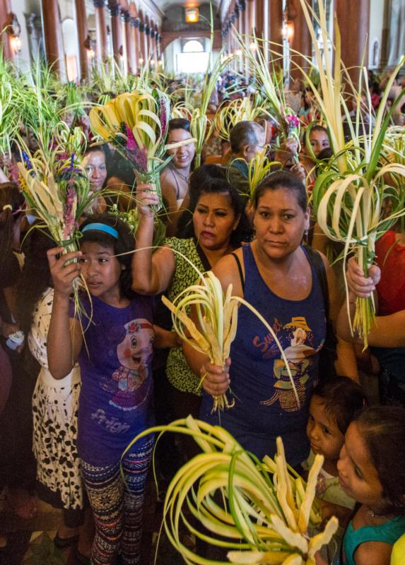 Parishioners at St. Lucy Parish in Suchitoto, El Salvador, wait to have their palms blessed during a Palm Sunday Mass March 29, 2015. The liturgy on Palm Sunday begins differently from most Masses. (CNS photo/Octavio Duran)