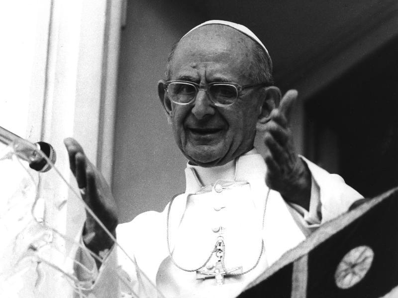 "Blessed Paul VI greets people gathered outside the papal summer house in Castel Gandolfo, Italy, Sept. 14, 1977. His 1967 contribution to the church's social tradition, ""Populorum Progressio,"" has been called the ""Magna Carta on development."" (CNS photo/Arturo Mari, L'Osservatore Romano)"