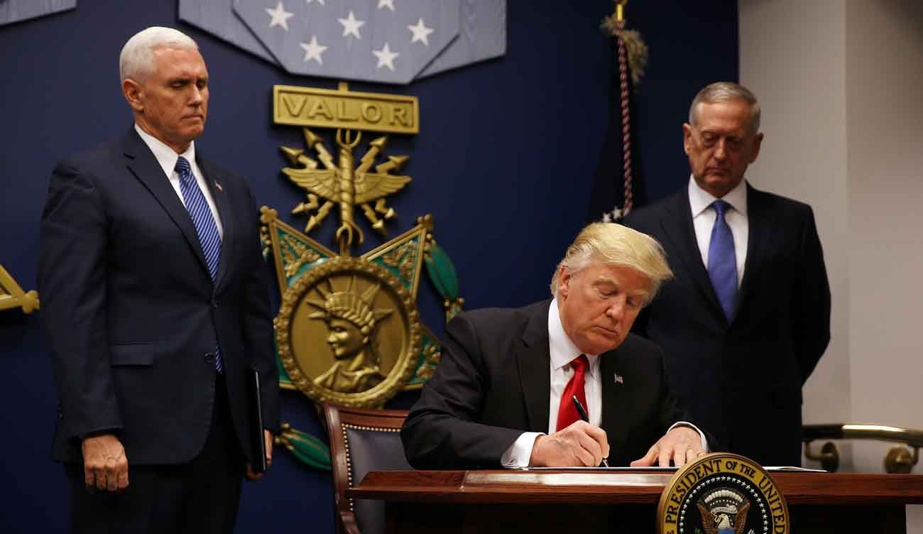 U.S. President Donald Trump signs a revised executive order for a U.S. travel ban March 6 at the Pentagon in Arlington, Va. He vowed to fight the latest court ruling blocking his executive order. (CNS photo/Carlos Barria, Reuters)
