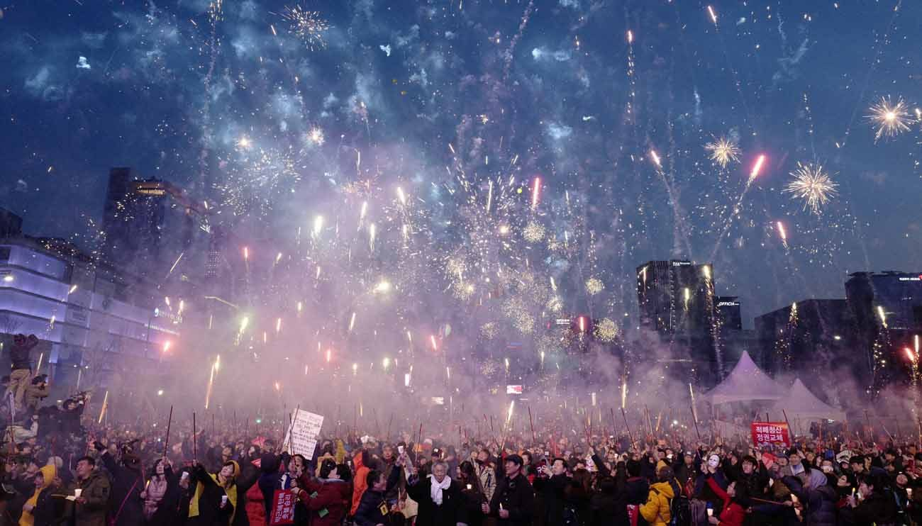 Fireworks explode in Seoul as South Koreans gather to celebrate March 11 after a court upheld the impeachment of South Korean President Park Geun-hye. Catholics in South Korea called for unity following the March 10 ruling. (CNS photo/Paul Haring)