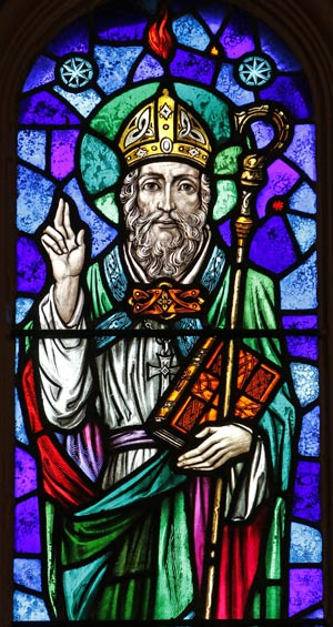 "St. Patrick is depicted in a stained-glass window at St. Aloysius Church in Great Neck, N.Y. Archbishop Eamon Martin of Armagh, Northern Ireland, said that ""as Irish people, we cannot think of St. Patrick without acknowledging the enormous humanitarian and pastoral challenges facing growing numbers of people who find themselves displaced and without status in our world."" (CNS photo/Gregory A. Shemitz) See MARTIN-SAINT-PATRICK-SLAVE March 16, 2017."