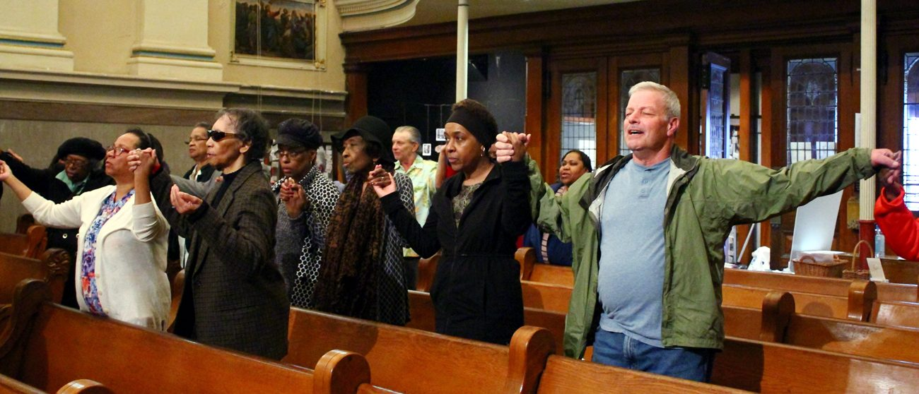 Parishioners of St. Vincent de Paul Parish in Philadelphia's Germantown section raise their hands and hearts in prayer during the 24 Hours for the Lord devotions last weekend, March 24-25. (Sarah Webb)