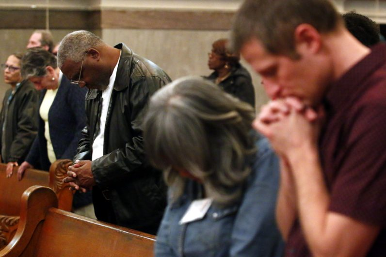 Jerry Smith prays during Mass.