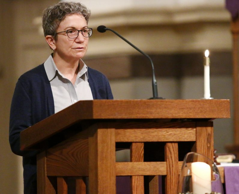 Lector Jacki Lynch reads during the Saturday evening vigil Mass at St. Vincent de Paul Church.
