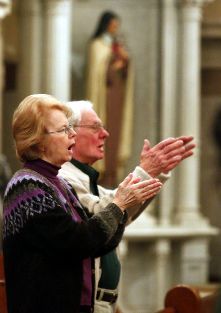 Liz Fuller and Bud Bretschneider pray together at St. Vincent de Paul Church in the Germantown section of Philadelphia.