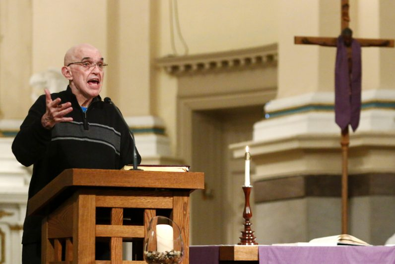 Father Sylvester Peterka, C.M., parish pastor, reminds the congregation of upcoming events at St. Vincent's as Lent comes to an end.