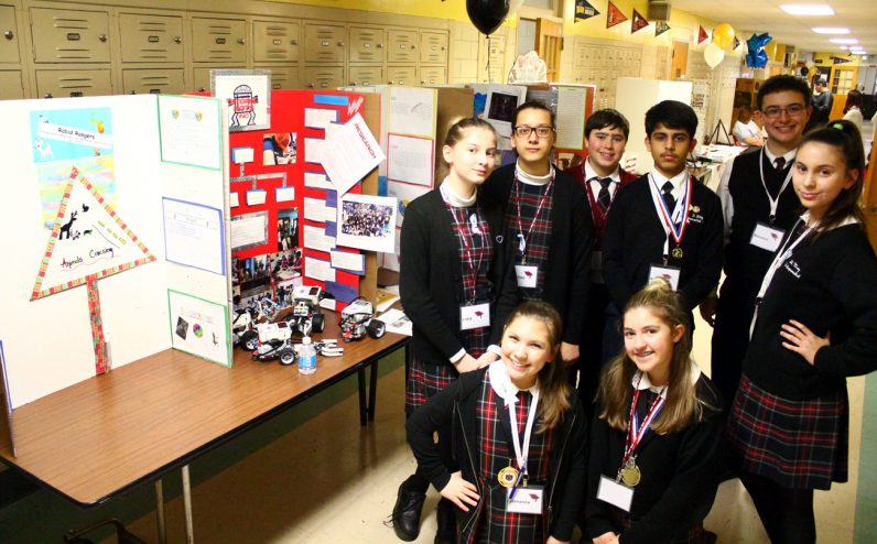 Students from St. Mary Interparochial School show off their robotics projects.