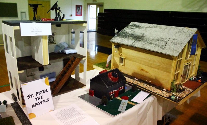 Students from St. Peter the Apostle School built functioning energy-efficient home models.