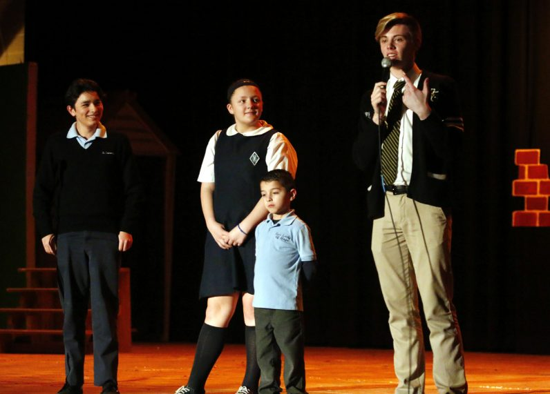 From left, Ryan Hewitt, the senior class vice president at SS. Neumann and Goretti High School, emcees the Showcase of Excellence on March 28.