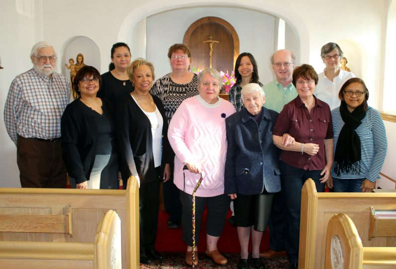 Sisters of St. Joseph, committee members and volunteers of the Outreach Center pose for a picture in the convent chapel.