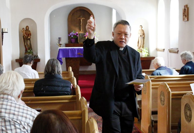 Msgr. Joseph Trinh, pastor of St. Helena Parish, blesses the chapel in the convent where the new Outreach Center will be located.