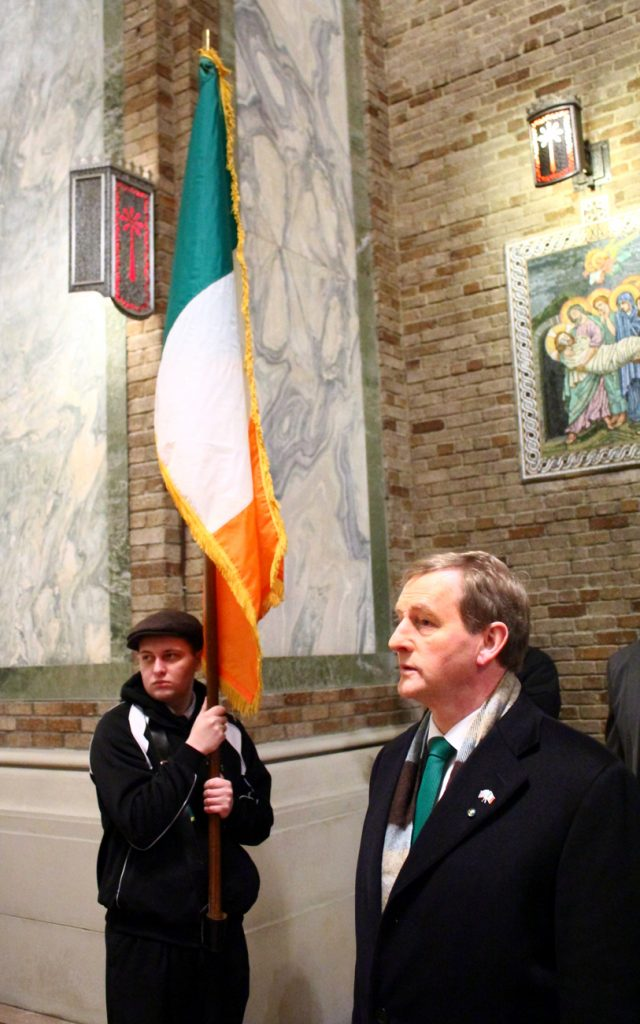 Irish Prime Minister Enda Kenny pauses for the singing of the national anthems of the United States and Ireland.