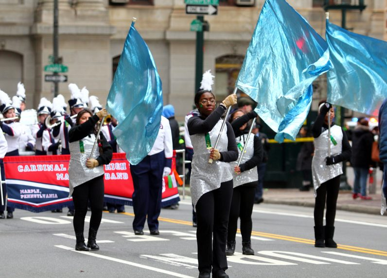 Cardinal O'Hara High School students proudly perform in the St. Patrick Day Parade.