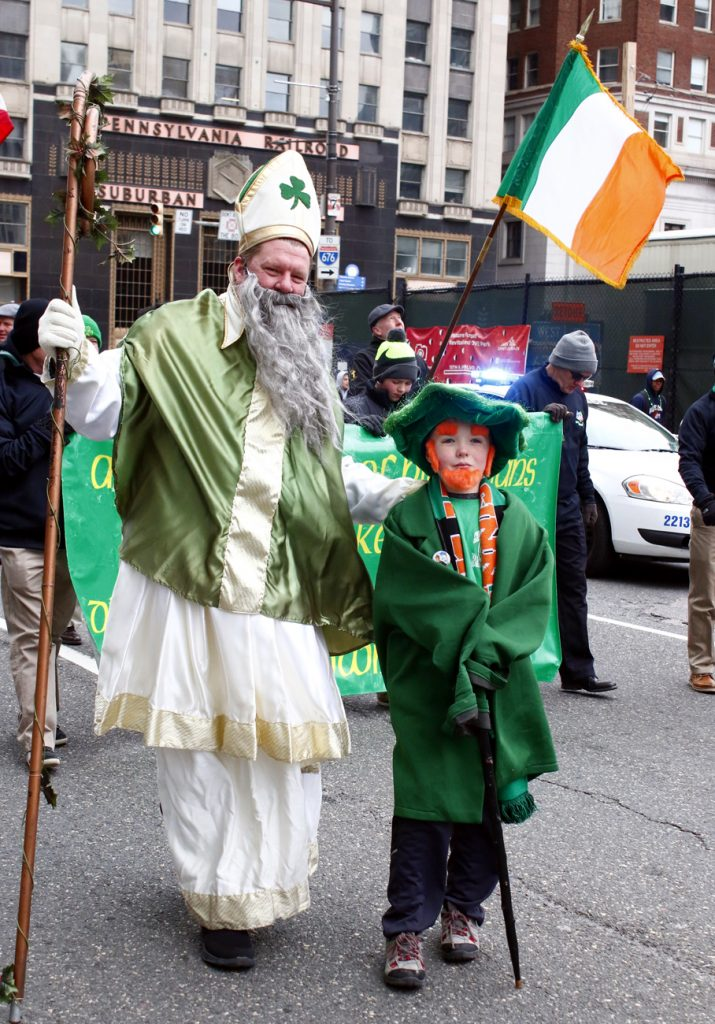 John Cooke, president of Bonnor-Prendergast High School and a parishioner of St. Dorothy in Drexel Hill, dresses up with his son to march in the parade.